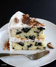 Oreo Heath Cake - White cake with Oreo chunks, Heath frosting, and chopped up Heath bar toppings. (from I Am Baker)