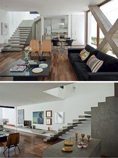 O X estrutural de concreto: elemento construtivo com status de obra de arte. Escada e aparador para TV igualmente em concreto descontraem os ambientes eoferecem um acento minimalista.