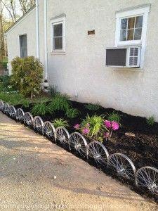 repurposed bike rims as garden edging/fence