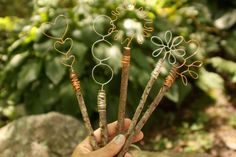 HOMEMADE BUBBLE WANDS  so easy and so cute. Items: some twigs from the yard, some copper, brass or silver jewelery wire from the craft store  bubble solution:: You can give the sticks a clean cut with a saw or just try to snap them up evenly by hand::Gardening shears will work nicely as wire cutters, but scissors would do the job too. Just do a little twisting and voila:: the simplest bubble recipe was just non-organic dish soap (dawn)  water (about one cup of soap to 4 cups of water)::