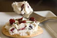 Cranberry Spread: Cream cheese, dried cranberries, rosemary, garlic, salt and pepper. Easy, fast, and doesn't require an oven so it's easy to transport. #Christmas #appetizer