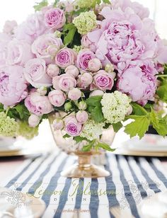 Loving this color combo and mix of peonies with roses and greenery! Of course the striped runner is icing on the cake!