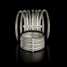 7 bracelets held together by an 'I Love You 7 Days a Week' inscription, this Charles Krypell bangle makes a brilliant expression of love.
