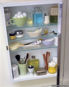 Reorganize your medicine cabinet. Found objects and flea-market bargains make appealing, practical keepers for toiletries. A vintage teacup makes a pretty container for cotton balls, and an eggcup doubles as a bobby-pin dispenser. Use a tin shaker as a talcum-powder sprinkler, and an old flask to hold mouthwash. Don't forget to clean containers thoroughly and carefully label all medicines.