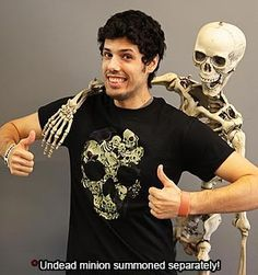 Celebrate Mogloween in style in this spook-tacular Tee as you prepare for the greatest quest of your life: to collect as much sugary candy as possible! The tricks and treats don't end there; this shirt comes with a special code that unlocks the NeverMore Armor in AdventureQuest Worlds. Happy Halloween boys and ghouls!