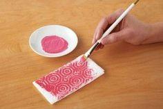 scrapbook paper, paint, paper towel