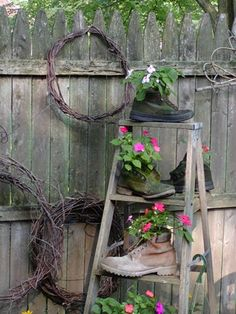 Yard Art ladder, garden art, yard art, flower pots, shabby chic decorating, old shoes, flowers, boots, boot planters