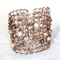 Knit wire cuff by lapisbeach. Or make it without beads.
