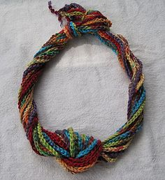 Long crocheted chain necklace.  What a clever idea, since this is what I do best with a crochet hook.  LOL!!!