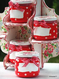 Polka dots and roses in red decoupaged kitchen shelf with 4 decoupaged glass jars