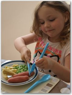 Learning knife and fork skills using play dough!