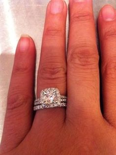 cushion cut split shank halo engagement ring -- I don't usually like this style, but this one is gorgeous
