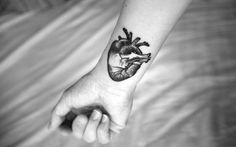 Heart tattoo via Tattoologist