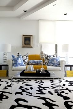 black white blue yellow living room; handwriting rug
