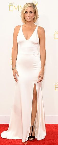 Kristen Wiig looked gorgeous in an ivory silk charmeuse gown with a plunging neckline by Vera Wang at the 2014 Emmys.