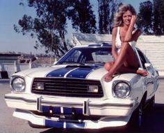 Farrah Fawcett Majors on the hood of her Ford Mustang Cobra II