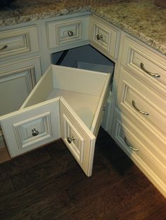 Another idea for the bottom blind corner cabinet space, as opposed to the lazy susan idea or sliding racks.