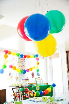 Colorful balloons create a festive scene for this robot theme birthday.  The balloon garlands and chandelier are air-filled, no helium required!  #air-filled #balloons
