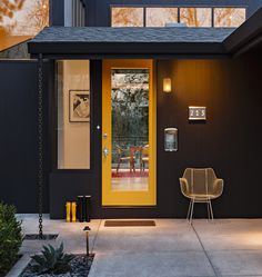 Yellow door, modern lighting and numbers, glass panels. Want everything in this picture.