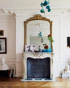 oversize mirror, as wide as the fireplace