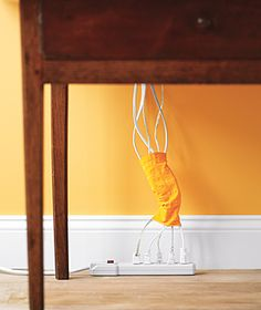 use a sock to organize cords