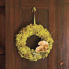 Naturally Beautiful | This moss-wrapped wreath looks like the handiwork of fairies, and most of the materials are just a nature walk away. | SouthernLiving.com