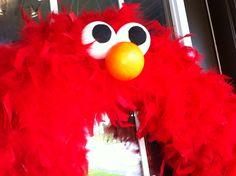 Elmo/Cookie Monster/Sesame Street Inspired Wreath. $30.00, via Etsy.