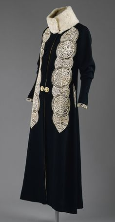 Coat, ca. 1919  Paul Poiret (French, 1879–1944)  Black silk and wool blend with white leather appliqués and white fur trim