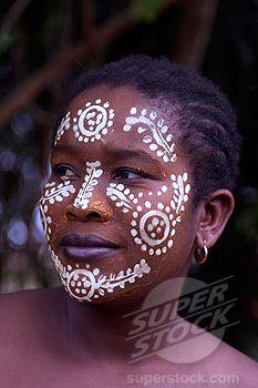Woman wearing decorative white face paint, Nosy Komba, Madagascar.