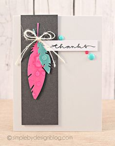 """handmade thank-you card ... clean and simple design ...  charcoal panel ... die cut feathers in hot pink and turquoise ... white twine ... enamel dots ... hand scrip """"thanks"""" ... beautiful!!"""
