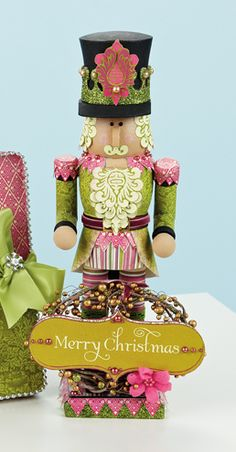 Festive Paper Crafted Nutcracker for Christmas. Gotta make one of these for my nutcracker collection!