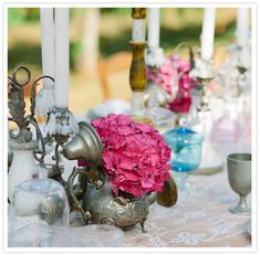 vibrant fuschia hydrangea centerpiece - love flowers inside of found objects