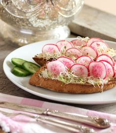 *French Radish Sandwich - Whole wheat french loaf, cut on the diagonal and toasted  Boursin cheese, I used the garlic and herb  Radishes, washed well and sliced  Alfalfa sprouts, or sprouts of your choice
