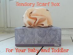Super simple sensory scarf box for your baby or toddler! Helps develop fine motor skills and tactile discrimination!