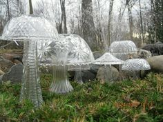 Old cut glass punch bowls and vases upcycled into garden mushrooms!