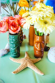 tiki head vases and ocean themed centerpieces
