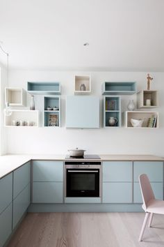 Loosely arranged painted boxes instead of upper cabinets in the kitchen. Love this! A nice alternative to the big boxy cabinets or floating shelves trends. Also, the variation in blue colors is quite lovely.