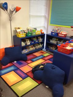 Designing cozy reading nooks for students to use for free reading allows students to read for enjoyment rather than school. Adding comfy chairs and lamps makes the classroom feel more inviting and encouraging for new, or struggling readers.
