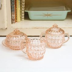 Depression glassware in a delicate pink shade.
