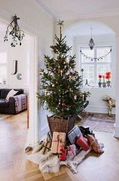 Traditional Danish Christmas tree. Also love the white walls. Lots of light here.