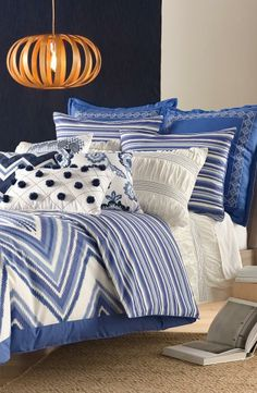 Beautiful bedding collection. Adore the mixed patterns and blue hues.