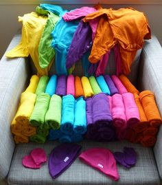 Dye a bunch of white baby clothes and accessories and save a bundle! They have clothing dye for sale by the laundry things at most stores. You could do it like tie dye, but just use 1 color :)