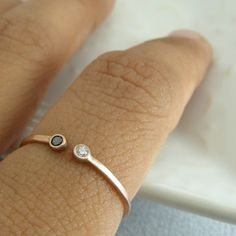his & her birthstone ring. I love how simple and delicate this is.