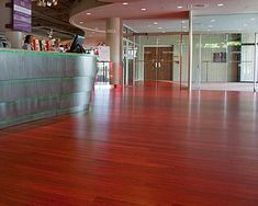 The flooring is red cork floor tiles by Duro Design