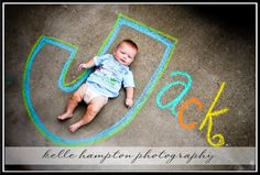 Creative birth announcement photo ideas| Baby's name in chalk. (Look at those thighs!)