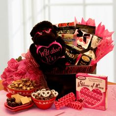 """I've Got Lotsa Luv Wild About You Gift Box    This adorable gift will make anyone smile 13"""" Wild about you gorilla,  Ribbons of Love Cinnamon Candy,   Ghirardelli chocolate bar,   Chocolate fudge covered popcorn,   White chocolate covered pretzels,   Almond toffee chocolates,   Valentines hearts gift box with caramel milk   chocolate and butter toffee pretzels.   Completed by a black gift box and topped with a pink zebra bow.    SHOP NOW: www.Kimslabellabaskets.com"""