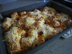 Mock enchiladas using taco meat and a can of refrigerated biscuits.  Sounds easy and looks great!