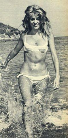 Catherine Deneuve in the surf