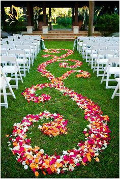 flower petals decorating the aisle, then when the bride walks down her dress trails through the petals!
