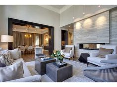 Contemporary living room - cool stone, grey and beige accented door frame in black by Nam Dang Mitchell